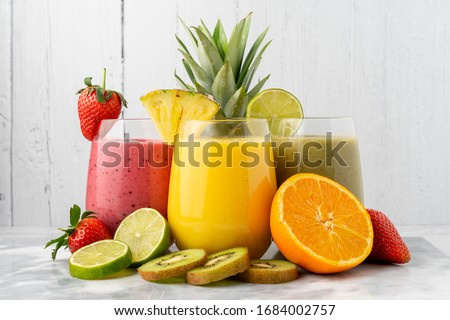 Photo of  Variety of fruit smoothies, with their ingredients.