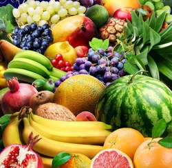 Variety of fruits and berries. Food fruits background.