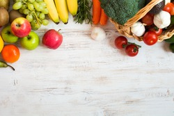Variety of fruits and vegetables, on the white wooden table, top view, copy space, selective focus