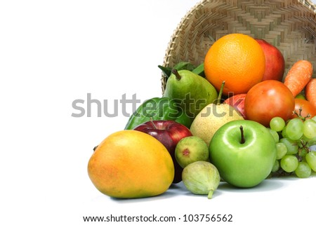 Variety of fruits spilled on white