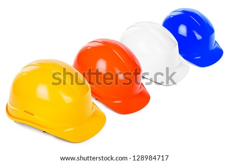 variety of hard hats on white background