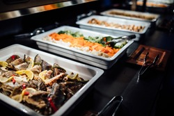Variety of healthy dishes decorated and served for a special occasion celebration buffet dinner.Mediterranean ketogenic diet.Grilled fish and vegetables.Healthy wedding dinner restaurant buffet menu