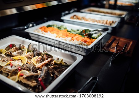 Variety of healthy dishes decorated and served for a special occasion celebration buffet dinner.Mediterranean ketogenic diet.Grilled fish and vegetables.Healthy wedding dinner restaurant buffet menu Сток-фото ©