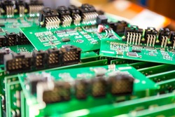 Variety of Just Produced Automotive Printed Circuit Boards with Surface Mounted Components with PCBs On Top of Boards. Shallow DOF.  Horizontal Image