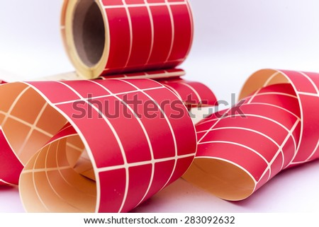 Variety of labels on a roll for customer or company info, logos, color schemes removed