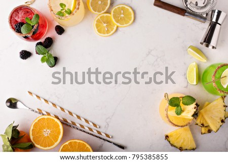 Variety of margarita cocktails with bartender tools overhead shot with copyspace