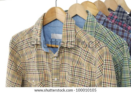 Variety of Men's different colors short sleeved plaid cotton on a hanger