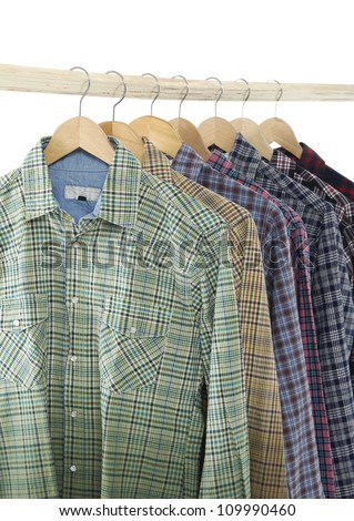 Variety of Men's different sleeved plaid cotton on a wooden hanger