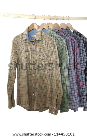 Variety of Men's sleeved plaid cotton on a wooden hanger