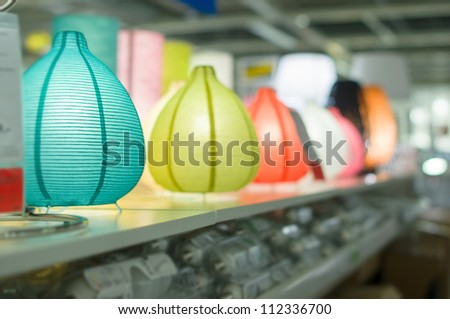 Variety of modern table  lamps on shelves in supermarket