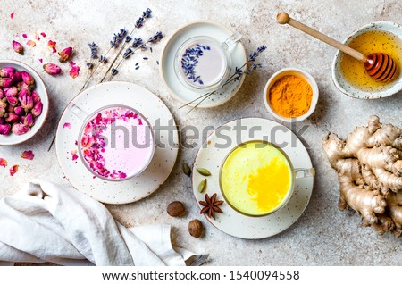 Variety of Moon Milk for a better sleep. Turmeric golden milk, pink rose milk and lavender moon milk. Trendy relaxing bedtime drink