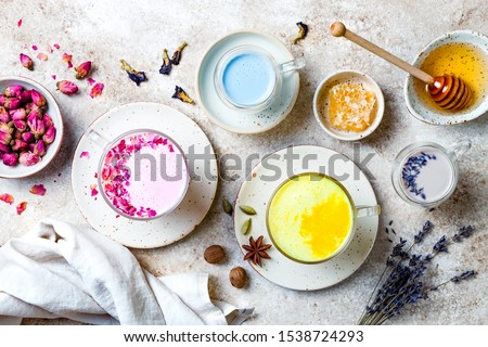 Variety of Moon Milk for a better sleep. Turmeric golden milk, pink rose milk, blue butterfly pea and lavender moon milk. Trendy relaxing bedtime drink