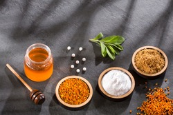 Variety of natural sweeteners - Pollen, honey, sugar and stevia leaves.