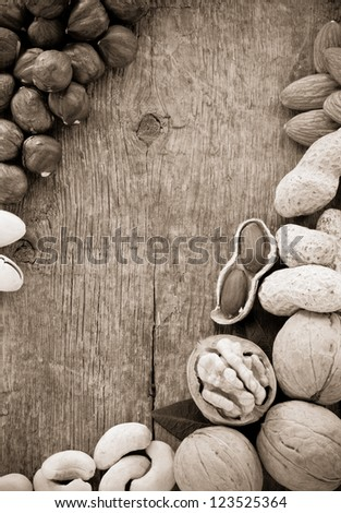 variety of nuts on wood background - stock photo