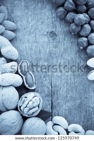 variety of nuts on wood background