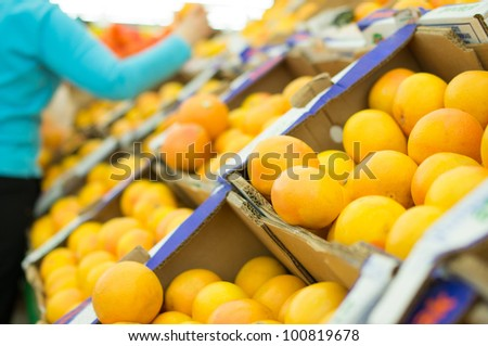 Variety of oranges in boxes in supermarket