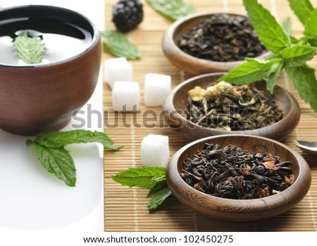 Variety Of Organic Tea And A Tea Cup