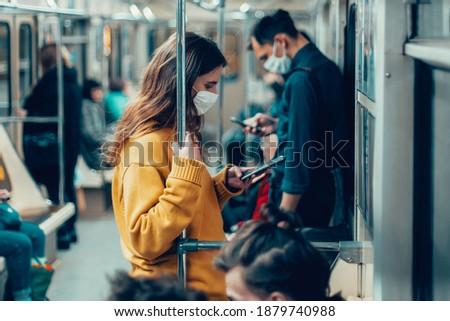 variety of passengers ride the subway car