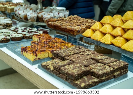 Variety of pastry on the display in a cafe