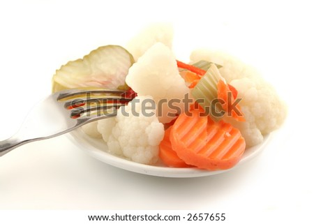 variety of pickled vegetables with fork on the side