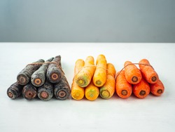 Variety of Purple, Yellow and Orange Carrots Tied Together
