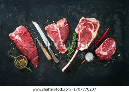 Variety of raw beef meat steaks for grilling