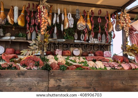 Variety of Raw Meat and sausages in Butcher Shop on Wooden Board Stockfoto ©