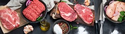 Variety of raw meat  with seasoning  on dark background. Top view, panorama, banner