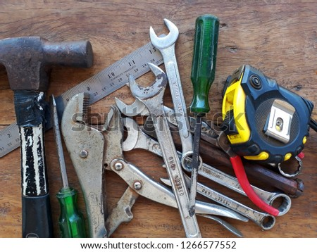 Variety of repair tools on wooden background, Old tools renovation, Repair tools.