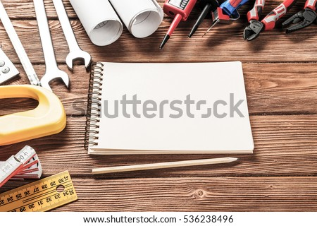 Variety of repair tools on wooden surface and place for text #536238496