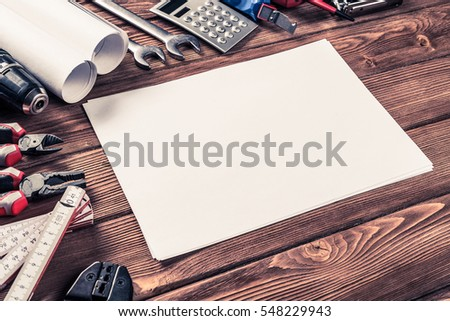 Variety of repair tools on wooden surface and place for text #548229943