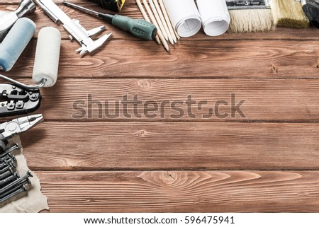 Variety of repair tools on wooden surface and place for text #596475941