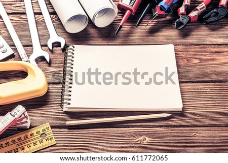 Variety of repair tools on wooden surface and place for text #611772065