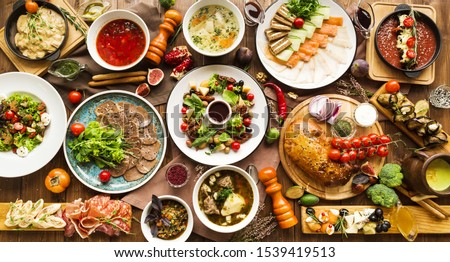 variety of restaurant dishes of national Georgian Armenian and Azerbaijani cuisine