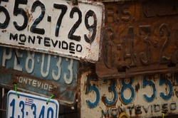 Variety of rusty and old car plates