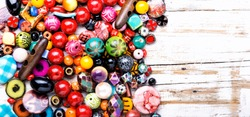 Variety of shapes and colors to make a bead necklace.Colored beads.