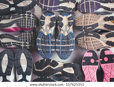 Variety of shoes.Different shoe sole on a grey background.