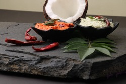 Variety of South Indian Chutney like coconut, tomato served in bowls,