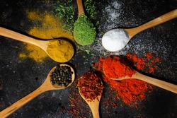 Variety of spices and herbs on black background