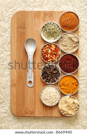 variety of spices on bamboo cutting board