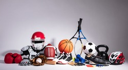 Variety Of Sport Balls And Equipment In Front Of Gray Surface