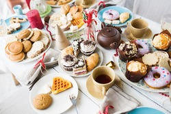 Variety of sweet food on festive table served for celebration