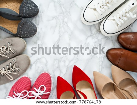 Variety of the colorful woman shoes on white, marble, elegant background. High hilles and sneaker shoes standing in circle on white background, Top view, flatlay, flat lay, woman, femine #778764178
