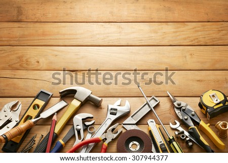 variety of tools on wood planks with copy space #307944377