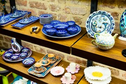 Variety of traditional colorful handcrafted ceramics on shelves of souvenir shop in Istanbul, Turkey