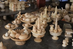 Variety of traditional handcrafted ceramics on shelves of souvenir shop