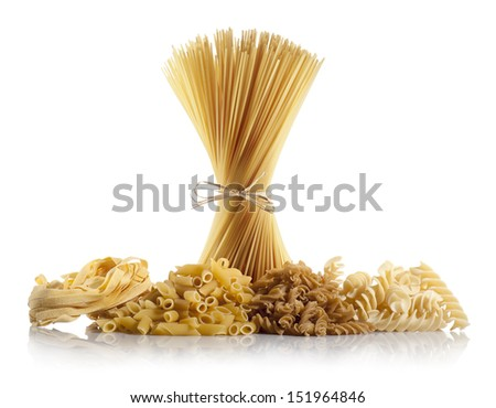 variety of uncooked pasta on white background
