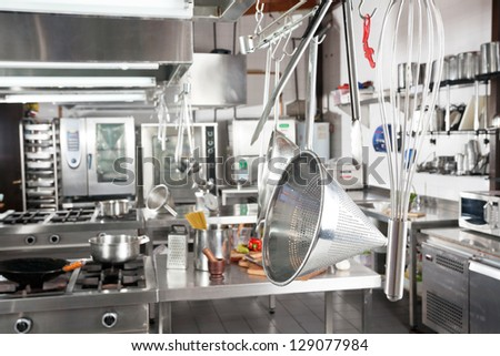 Variety of utensils hanging in commercial kitchen