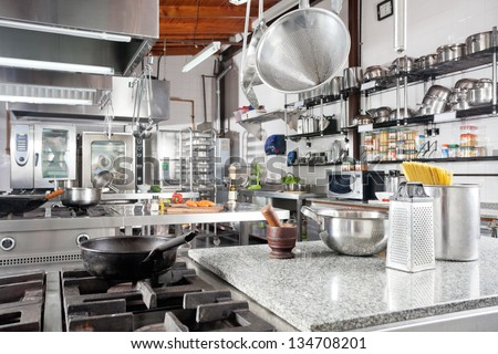 Variety of utensils on counter in commercial kitchen #134708201