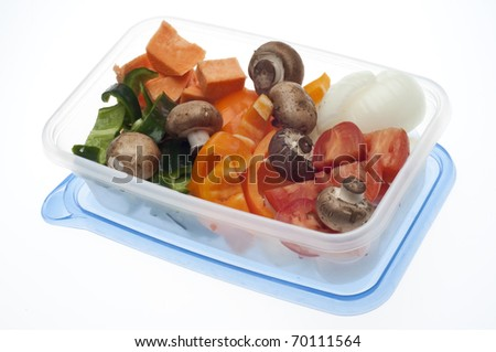 Variety of Vegetables Mushroom, Pepper, Onion, Tomato, and Sweet Potato in a Plastic Container.